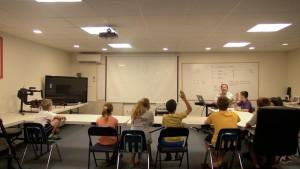 Dan Hallissey, Dedham Television's Director of IT, Operations, and Training, teaches the kids video production at our Summer Camps.