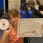 Summer Camps – Michelle, Dan's Daughter, Proudly Holds Up Her Certificate and DVD!
